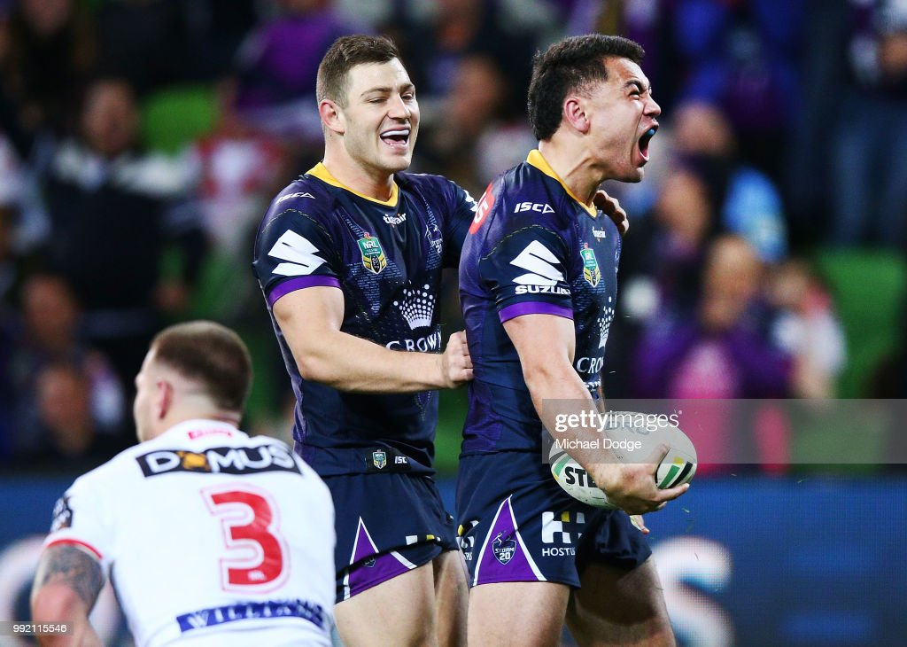 Jahrome Hughes of the Storm celebrates a try during the round 17 NRL match between the Melbourne Storm and the St George Illawarra Dragons at AAMI Park on July 5, 2018 in Melbourne, Australia.