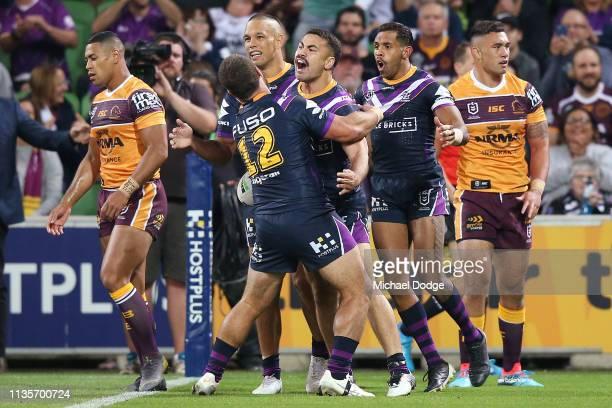 Jahrome Hughes of the Storm celebrates scoring a try during the round one NRL match between the Melbourne Storm and the Brisbane Broncos at AAMI Park...