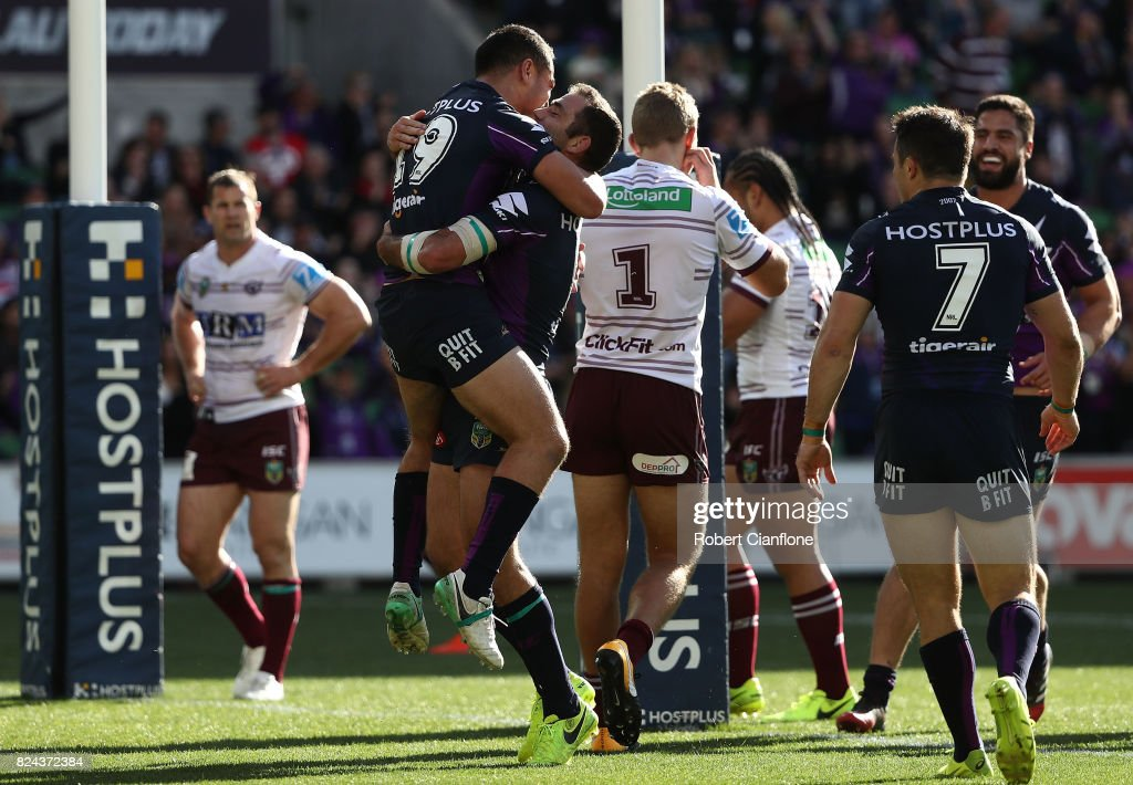 Jahrome Hughes of the Storm celebrates with Cameron Smith after scoring a try during the round 21 NRL match between the Melbourne Storm and the Manly Sea Eagles at AAMI Park on July 30, 2017 in Melbourne, Australia.