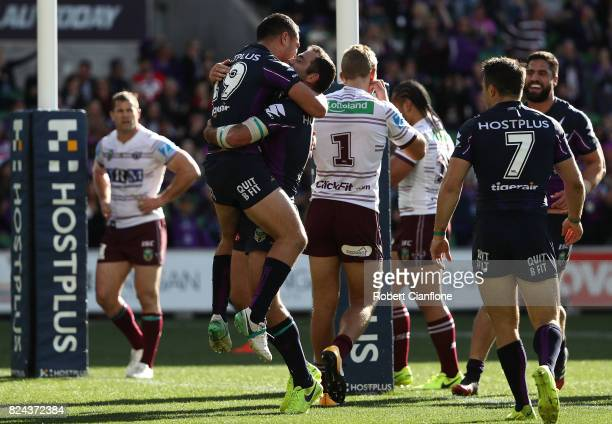 Jahrome Hughes of the Storm celebrates with Cameron Smith after scoring a try during the round 21 NRL match between the Melbourne Storm and the Manly...