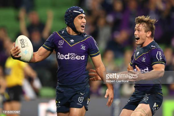 Jahrome Hughes of the Storm celebrates with team mates after scoring a try during the round eight NRL match between the Melbourne Storm and the...