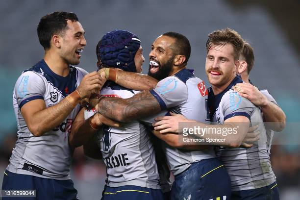 Jahrome Hughes of the Storm celebrates with team mates after scoring a try scores a try during the round nine NRL match between the South Sydney...