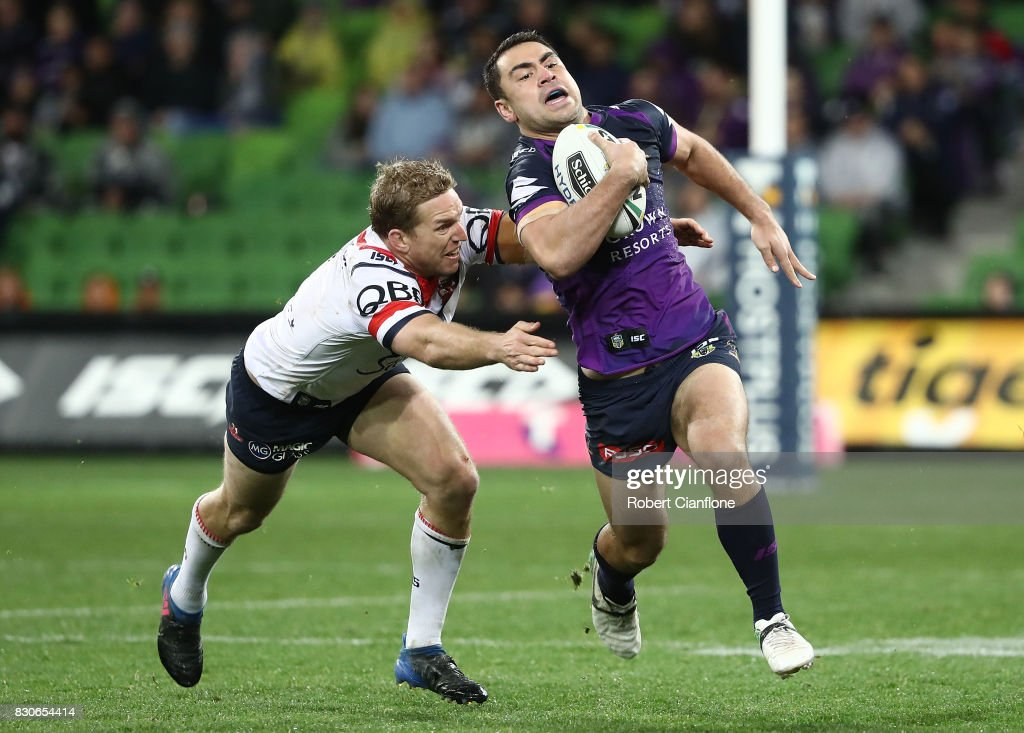 Jahrome Hughes of the Storm is challenged by Mitchell Aubusson of the Roosters during the round 23 NRL match between the Melbourne Storm and the Sydney Roosters at AAMI Park on August 12, 2017 in Melbourne, Australia.