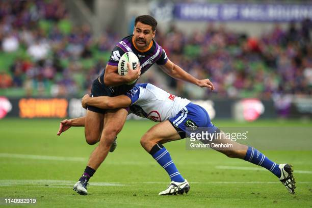 Jahrome Hughes of the Storm is tackled during the round four NRL match between the Melbourne Storm and the Canterbury Bulldogs at AAMI Park on April...
