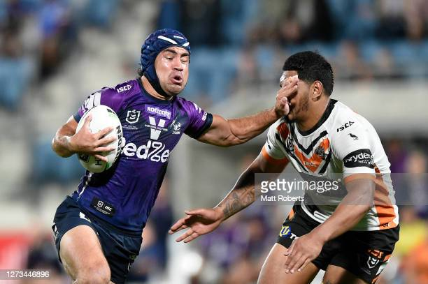 Jahrome Hughes of the Storm makes a break and scores a try during the round 19 NRL match between the Melbourne Storm and the Wests Tigers at Sunshine...