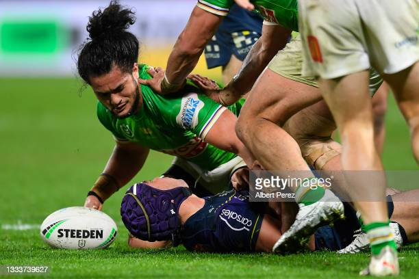 Jahrome Hughes of the Storm suffers a concussion after a tackle by Corey Harawira-Naera during the round 22 NRL match between the Melbourne Storm and...