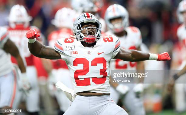 Jahsen Wint of the Ohio State Buckeyes celebrates during the BIG Ten Football Championship Game against the Wisconsin Badgers at Lucas Oil Stadium on...