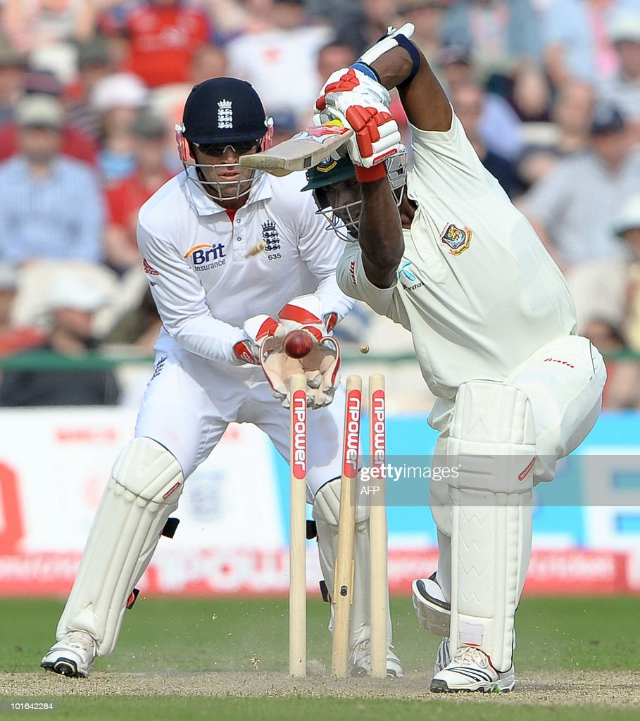 Jahurul Isam of Bangladesh (R) is bowled out by England's Graeme Swann (not in picture) during the second day of the second Test match at Old Trafford in Manchester, north-west England on June 5, 2010.