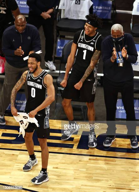 Jahvon Blair and Jamorko Pickett of the Georgetown Hoyas celebrate the win over the Creighton Bluejays during the Big East Championship game at...