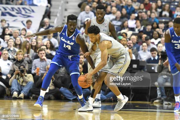 Jahvon Blair of the Georgetown Hoyas and Ismael Sanogo of the Seton Hall Pirates fight for a loose ball during a college basketball game at Capital...
