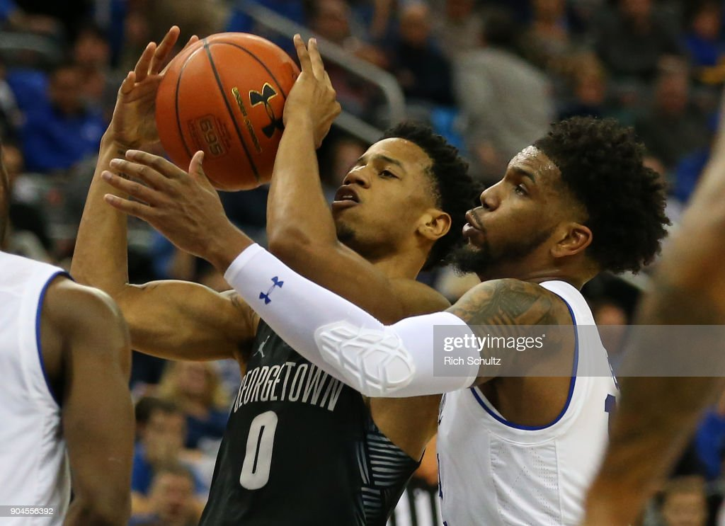 Jahvon Blair #0 of the Georgetown Hoyas attempts to fight off Myles Powell #13 of the Seton Hall Pirates during the first half of a game at Prudential Center on January 13, 2018 in Newark, New Jersey. Seton Hall defeated Georgetown 74-61.