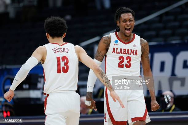 Jahvon Quinerly and John Petty Jr. #23 of the Alabama Crimson Tide react in the second half against the Maryland Terrapins in the second round game...