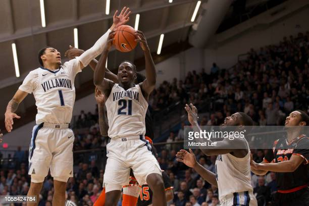 Jahvon Quinerly Dhamir CosbyRoundtree and Eric Paschall of the Villanova Wildcats go up for a rebound against David Syfax of the Morgan State Bears...