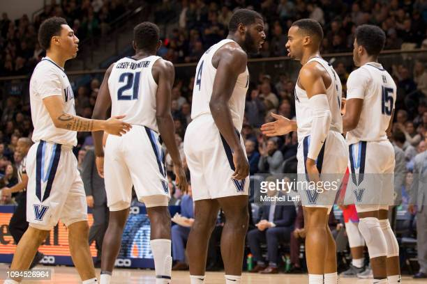 Jahvon Quinerly Dhamir CosbyRoundtree Eric Paschall Phil Booth and Saddiq Bey of the Villanova Wildcats in action against the DePaul Blue Demons at...