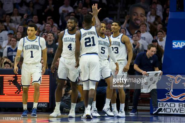 Jahvon Quinerly Eric Paschall Dhamir CosbyRoundtree Phil Booth and Jermaine Samuels of the Villanova Wildcats react against the Georgetown Hoyas at...