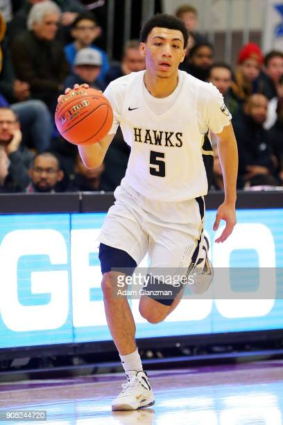 Jahvon Quinerly of Hudson Catholic High School driubbles in a game against John Carroll School during the 2018 Spalding Hoopall Classic at Blake...