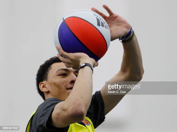 Jahvon Quinerly of Hudson Catholic Regional High School attempts a threepoint basket during the 2018 McDonald's All American Game POWERADE Jam Fest...