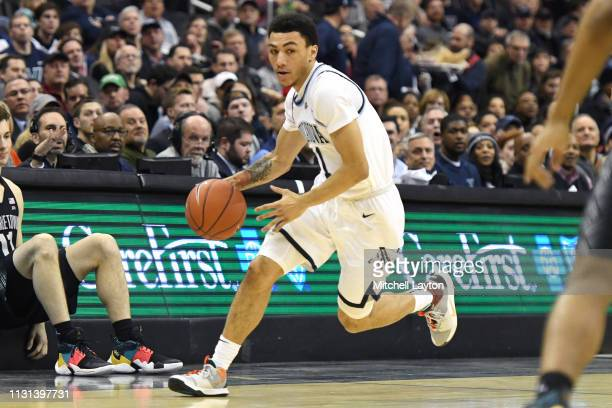 Jahvon Quinerly of the Villanova Wildcats dribbles down court during a college basketball game against the Georgetown Hoyas at the Capital One Arena...