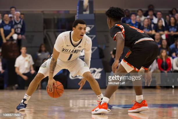 Jahvon Quinerly of the Villanova Wildcats dribbles the ball against Sherwyn DevonishPrince Jr #5 of the Morgan State Bears at Finneran Pavilion on...