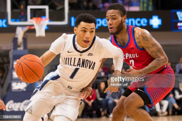 Jahvon Quinerly of the Villanova Wildcats dribbles the ball against Devin Gage of the DePaul Blue Demons at Finneran Pavilion on January 2 2019 in...