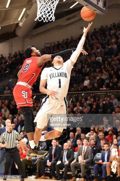 Jahvon Quinerly of the Villanova Wildcats dribbles to the basket over Shamorie Ponds of the St John's Red Storm during a college basketball game at...