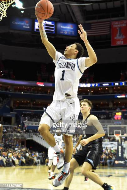 Jahvon Quinerly of the Villanova Wildcats drives to the basket during a college basketball game against the Georgetown Hoyas at the Capital One Arena...