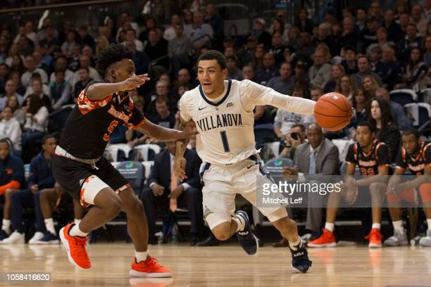 Jahvon Quinerly of the Villanova Wildcats drives to the basket against Sheryn DevonishPrince Jr #5 of the Morgan State Bears in the first half at...