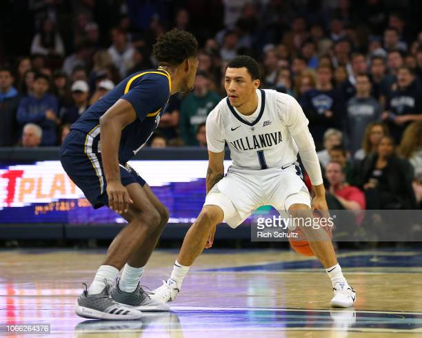 Jahvon Quinerly of the Villanova Wildcats in action against Cameron Young of the Quinnipiac Bobcats during a game at Wells Fargo Center on November...