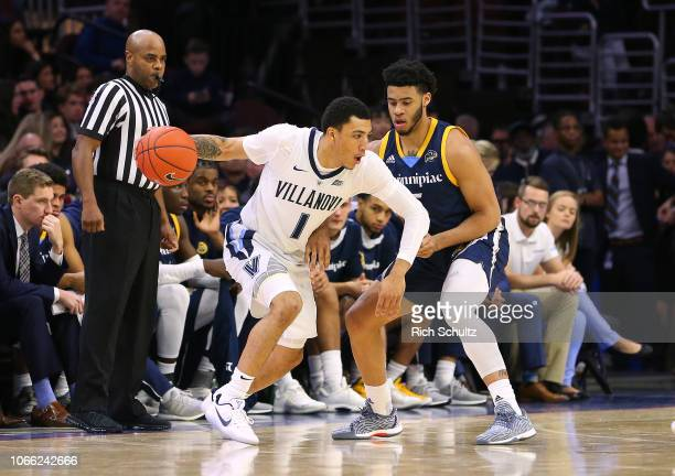 Jahvon Quinerly of the Villanova Wildcats in action against Tyrese Williams of the Quinnipiac Bobcats during a game at Wells Fargo Center on November...