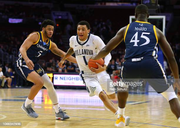 Jahvon Quinerly of the Villanova Wildcats in action against Tyrese Williams and Kevin Marfo of the Quinnipiac Bobcats during a game at Wells Fargo...