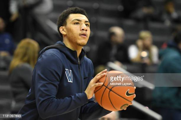Jahvon Quinerly of the Villanova Wildcats looks on before a college basketball game against the Georgetown Hoyas at the Capital One Arena on February...