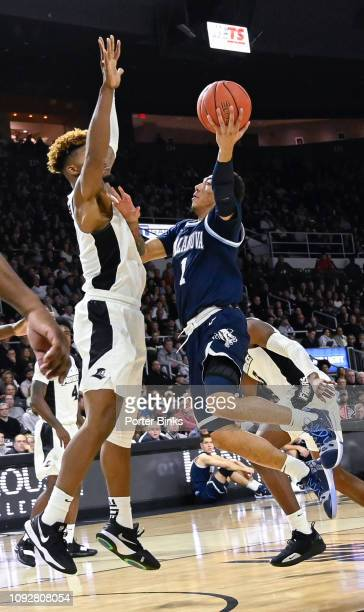 Jahvon Quinerly of the Villanova Wildcats shoots against the Providence Friars at Dunkin' Donuts Center on January 5 2019 in Providence RI