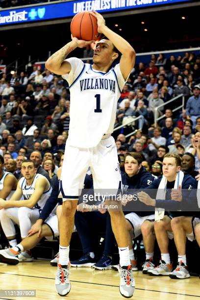 Jahvon Quinerly of the Villanova Wildcats takes a jump shot during a college basketball game against the Georgetown Hoyas at the Capital One Arena on...