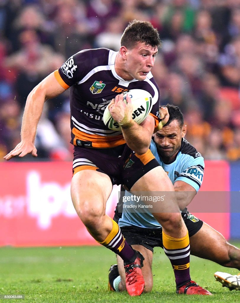 Jai Arrow of the Broncos attempts to break away from the defence during the round 23 NRL match between the Brisbane Broncos and the Cronulla Sharks at Suncorp Stadium on August 11, 2017 in Brisbane, Australia.