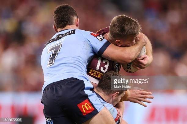 Jai Arrow of the Maroons is tackled during game one of the 2021 State of Origin series between the New South Wales Blues and the Queensland Maroons...