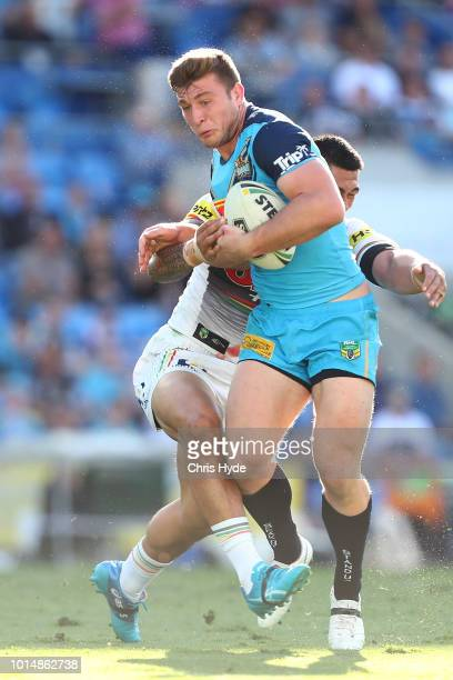 Jai Arrow of the Titans is tackeld during the round 22 NRL match between the Gold Coast Titans and the Penrith Panthers at Cbus Super Stadium on...