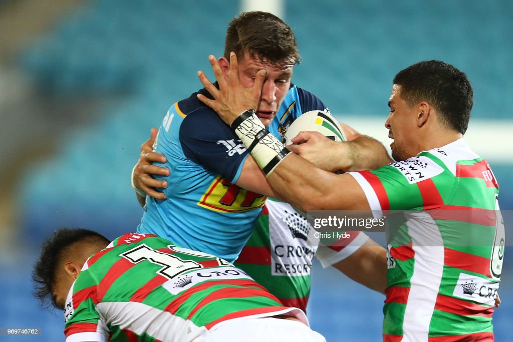 Jai Arrow of the Titans is tackled during the round 14 NRL match between the Gold Coast Titans and the South Sydney Rabbitohs at Cbus Super Stadium on June 8, 2018 in Gold Coast, Australia.