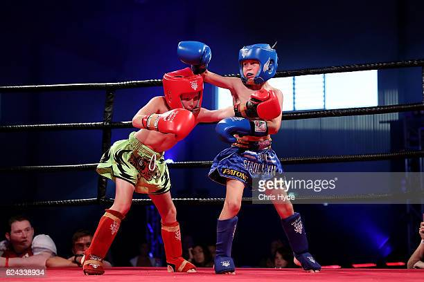 Jai Bowman and Orlando Nagy exchange punches during the Muay Thai fight in the Siam Junior show at Eagle sports complex on November 19, 2016 in...