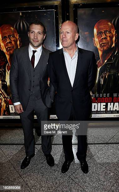 Jai Courtney and Bruce Willis attend the UK Premiere of 'A Good Day To Die Hard' at Empire Leicester Square on February 7 2013 in London England