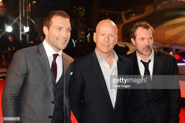 Jai Courtney Bruce Willis and Sebastian Koch attend the UK premiere of 'A Good Day To Die Hard' at The Empire Leicester Square on February 7 2013 in...