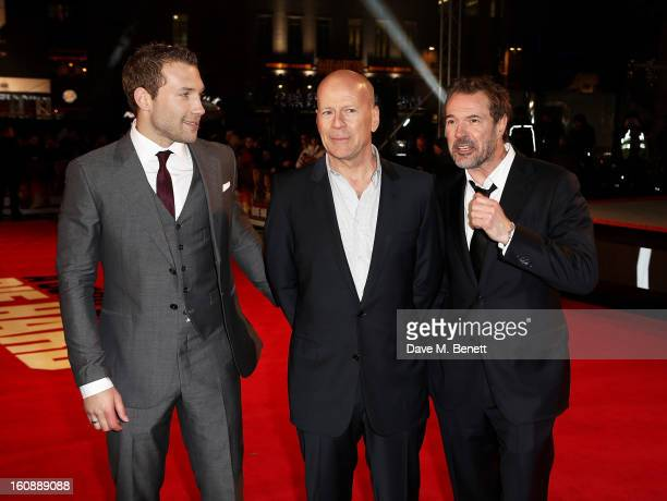 Jai Courtney Bruce Willis and Sebastian Koch attend the UK Premiere of 'A Good Day To Die Hard' at Empire Leicester Square on February 7 2013 in...