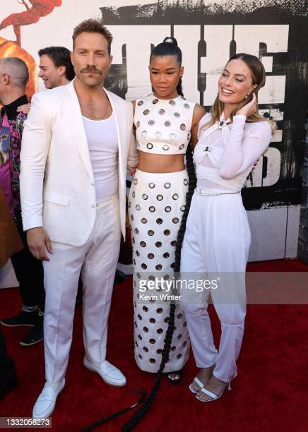 """Jai Courtney, Storm Reid, and Margot Robbie attend the Warner Bros. Premiere of """"The Suicide Squad"""" at Regency Village Theatre on August 02, 2021 in..."""