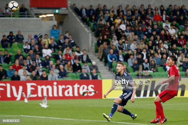 Jai Ingham of the Victory watches his header fly past the goal keeper during the AFC Champions League match between Melbourne Victory and Shanghai...