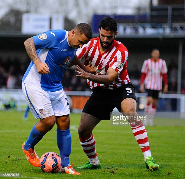 Jai Reason of Eastleigh challenges for the ball with Hamza Bencherif during the FA Cup First Round match between Eastleigh FC and Lincoln City at...
