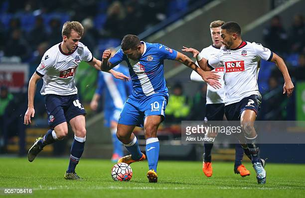 Jai Reason of Eastleigh controls the ball under pressure of Rob Holding and Liam Feeney of Bolton Wanderers during the Emirates FA Cup Third Round...