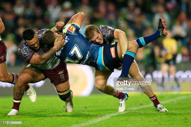Jai Whitbread of the Titans is tackled during the round 11 NRL match between the Manly Sea Eagles and the Gold Coast Titans at Lottoland on May 24,...