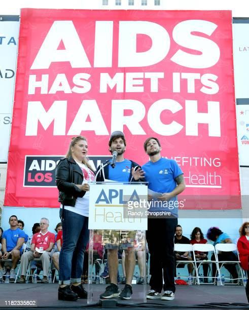 Jaicy Elliot Jake Borelli and Alex Blue Davis speak on stage during AIDS Walk Los Angeles 2019 on October 20 2019 in Los Angeles California