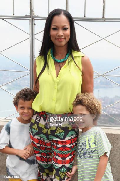 Jaid Thomas Nilon Garcelle Beauvais and Jax Joseph Nilon visit the Empire State Building on June 3 2013 in New York United States