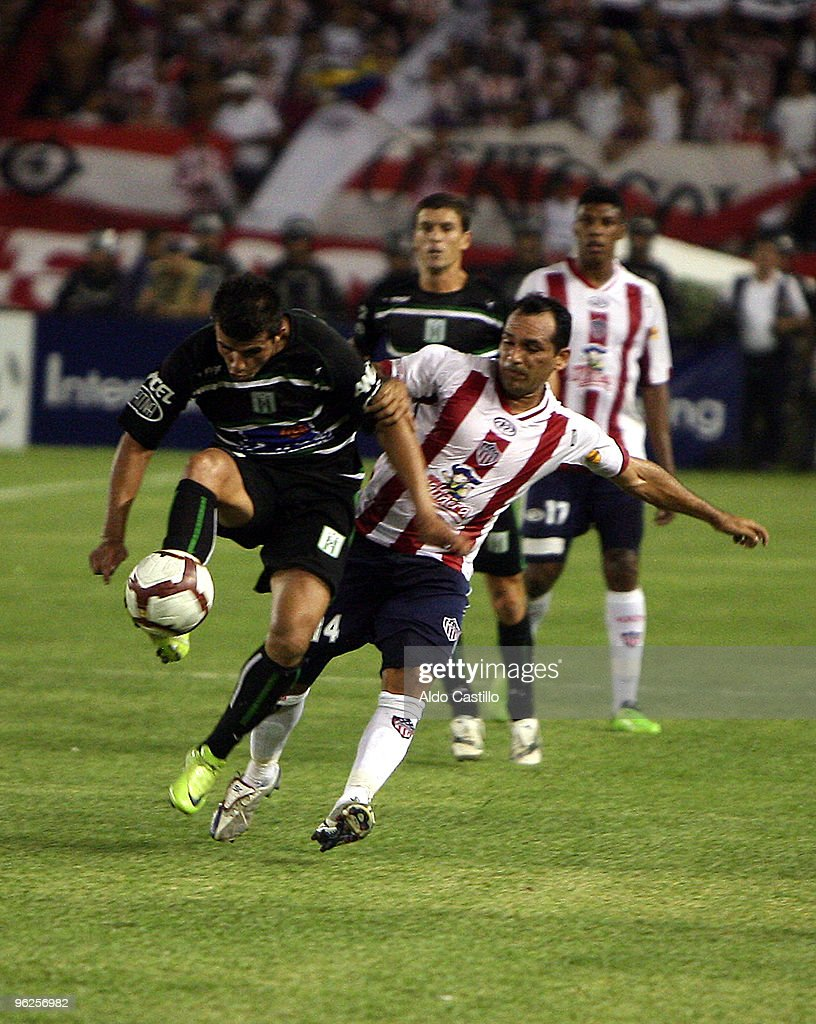 Jaider Palacios (R) of Colombia's Junior figths for the ball with Martin Cauteruccio of Uruguay's Racing during their match as part of the Santander Libertadores Cup 2010 at Metropolitano Roberto Melendez Stadium on January 28, 2010 in Barranquilla, Colombia.