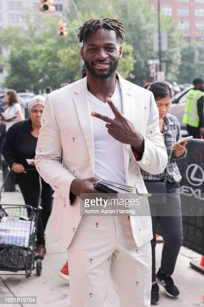 Jaidus Mondesir is seen wearing a custom suit on the street during New York Fashion Week on September 11 2018 in New York City